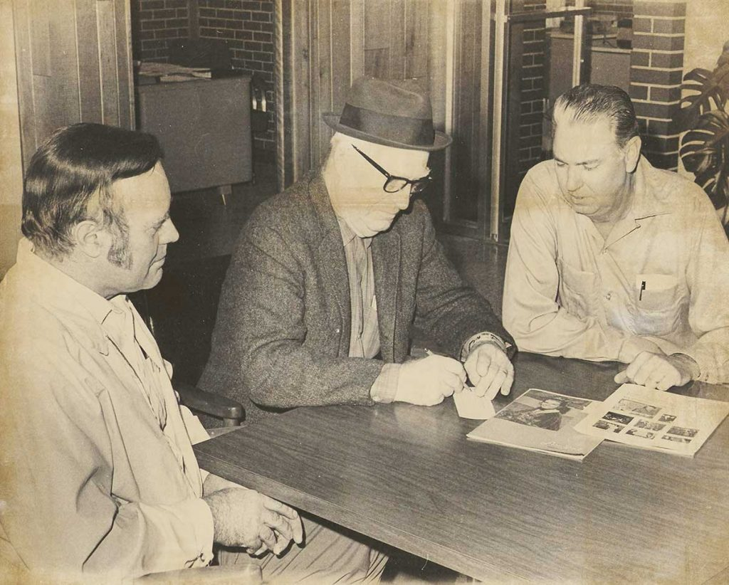 One of the strongest backers for soybean promotional work in Arkansas is Carl D. Yohe, Stuttgart (center), pictured here with Perry Yoho (left) and M. D. Lamberth, vice president of Jacob Hartz Seed Co.