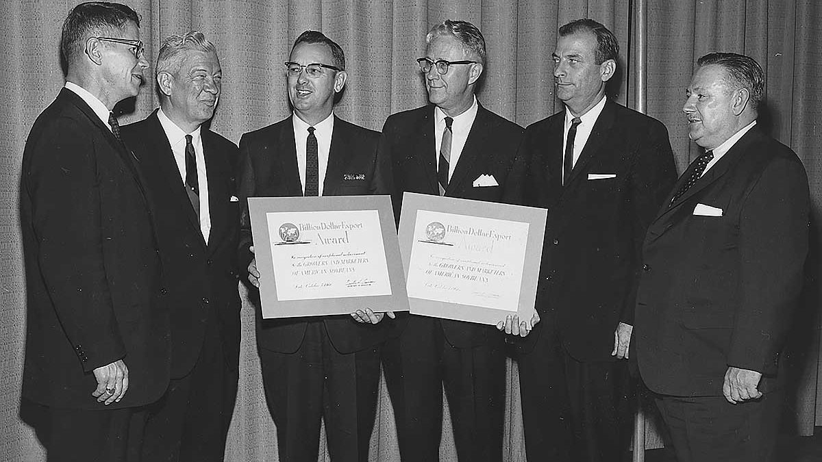 "U.S. Secretary of Agriculture Orville Freeman presents ""Billion Dollar"" export awards to the American Soybean Association and Soybean Council of America in 1966. In the photo from the left are Secretary Freeman; George Strayer, ASA executive vice president, Laurel Meade, ASA president; Glen Pogeler, Soybean Council of America president; and Ray Fiedler and A. H. Becker, Soybean Council of America."