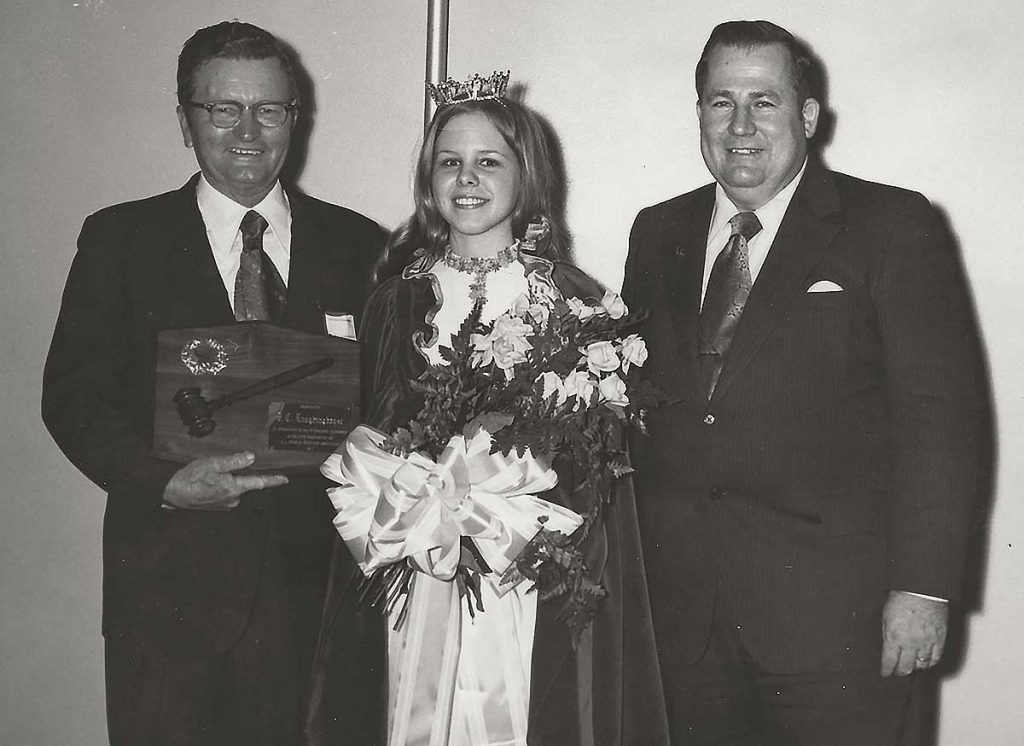 Highlighting the annual membership meeting of the North Carolina Soybean Producers Association (NCSPA) was the naming of the N. C. Princess Soya, Paula Jane Mitchell. Here she is with the past president and new president of NCSPA. On the left, Past president Fernie Laughinghouse and on the right, new president E. L. Rivenbark. Mr. Laughinghouse is ASA director from North Carolina. The new N. C. Princess Soya is the 18-year old daughter of Mr. and Mrs. Linwood Mitchell, Harrellsville, N. C. She is a freshman at East Carolina University, Greenville, where she is majoring in physical therapy. (Photo undated)