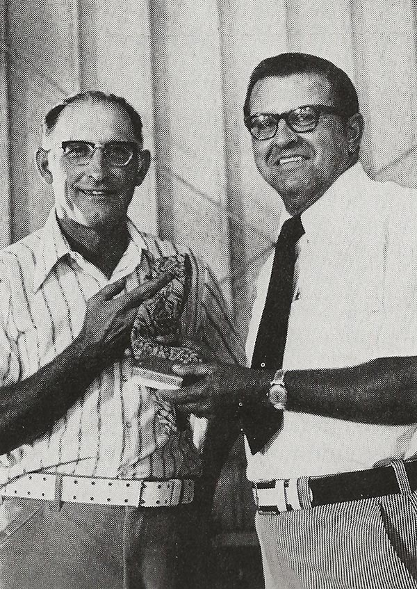 Vince Drendel (left), Evansville, president of the new Wisconsin Soybean Association in 1973, receives a complimentary gift and welcome into ASA from President Harold Kuehn.
