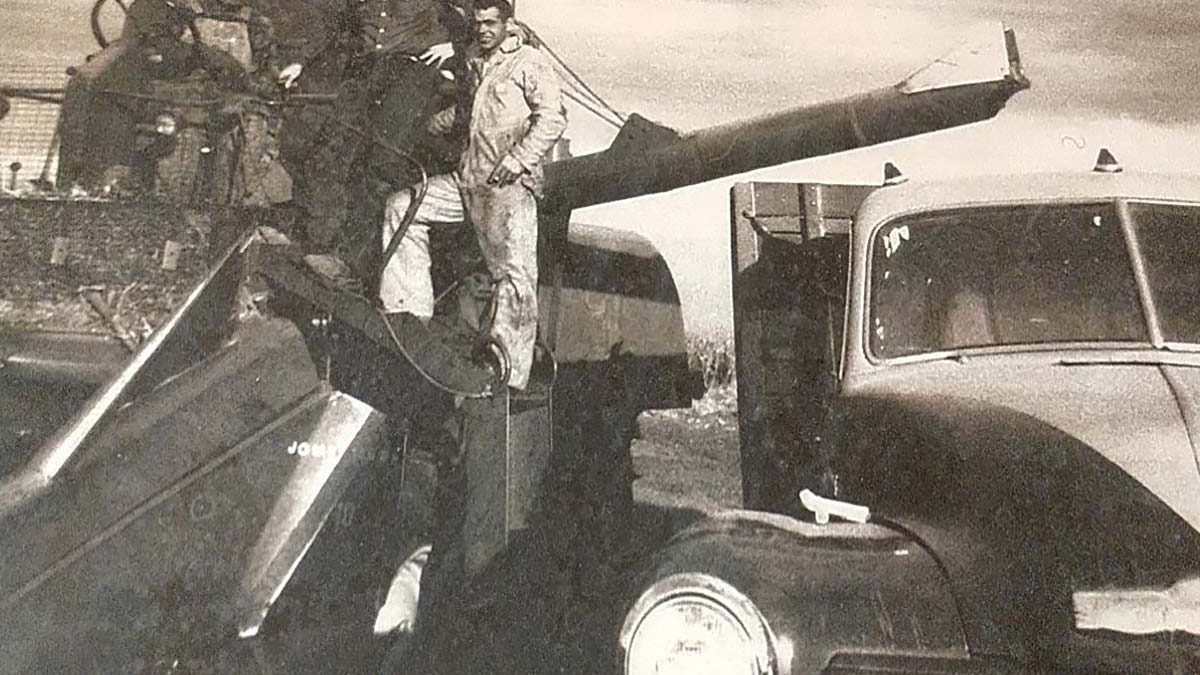 Harry Walters, Dick Walters and a hired hand on a John Deere Model 55, harvesting in 1958.
